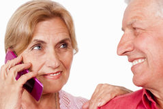 Elderly couple with phone Stock Image