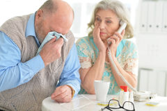 Elderly couple with pills. Portrait of an elderly couple with pills Royalty Free Stock Photo