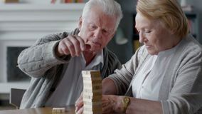 Elderly couple playing Board games