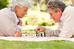 Elderly couple playing chess Royalty Free Stock Photo