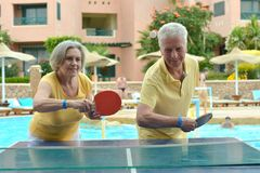 Elderly couple playing ping pong royalty free stock photo