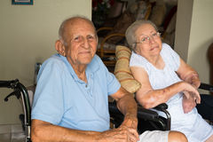 Elderly couple. Elderly 80 plus year old handicapped senior couple in a home setting royalty free stock images