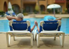 Elderly couple at pool Royalty Free Stock Image