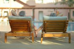 Elderly couple at pool Stock Photography