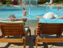 Elderly couple at pool Stock Image
