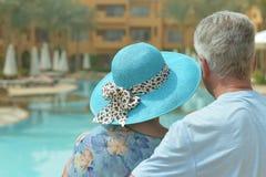 Elderly couple at pool Stock Photo