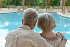 Elderly couple at pool Stock Image