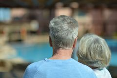 Elderly couple at pool Royalty Free Stock Photos