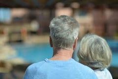 Elderly couple at pool Royalty Free Stock Photos
