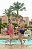 Elderly couple at pool Royalty Free Stock Photography