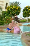 Elderly couple at pool Stock Images