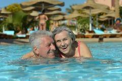 Elderly couple in pool Stock Photography