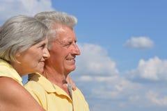 Elderly couple posing against the sky Stock Photo