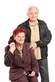 Elderly couple posing together Royalty Free Stock Image
