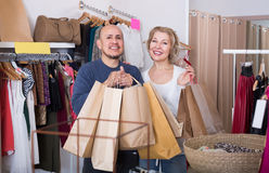 Elderly couple with purchases in bags Stock Images