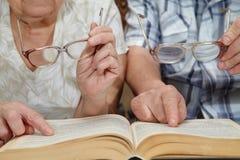 An elderly couple reading a book Stock Photos