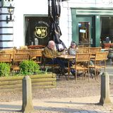 Senior couple chills at a scenic terrace in Dutch style, Lage Vuursche,Netherlands Stock Images