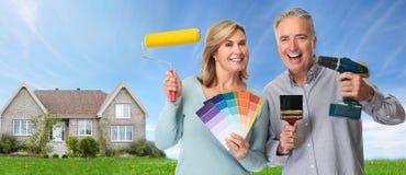Elderly couple with renovation tools Stock Photo
