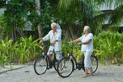 Elderly couple rest with bicycles Stock Photos