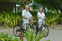 Elderly couple rest with bicycles Stock Photo