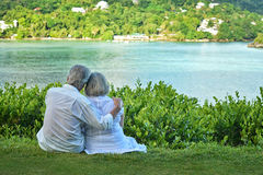 Elderly couple rest at tropical beach Royalty Free Stock Photo
