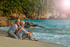 Elderly couple rest at tropical beach Royalty Free Stock Photos