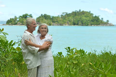 Elderly couple rest at tropical beach Stock Image