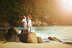 Elderly couple rest at tropical beach Royalty Free Stock Image