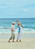 Elderly couple rest at tropical resort Stock Photography