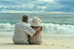 Elderly couple rest at tropical resort Stock Photos