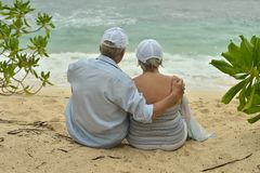 Elderly couple rest at tropical resort Royalty Free Stock Photos