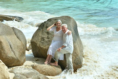 Elderly couple rest at tropical resort Royalty Free Stock Image