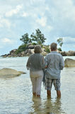 Elderly couple rest at tropical resort Royalty Free Stock Images