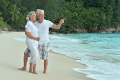 Elderly couple rest at tropical resort Stock Images