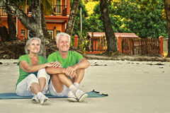 Elderly couple rest at tropical resort Royalty Free Stock Photography
