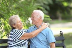 Elderly couple resting on bench stock image