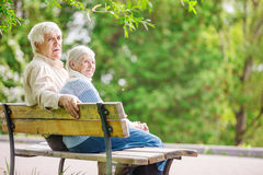 Elderly couple resting at the park Stock Images