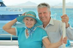 Elderly couple ride in boat on sea Royalty Free Stock Photo