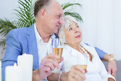 Elderly couple and romantic dinner. Elderly elegant married couple during romantic dinner with candles Royalty Free Stock Photography
