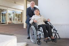 Elderly couple rushing for appointment Stock Image