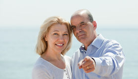 Elderly couple at sea shore Royalty Free Stock Images