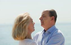 Elderly couple at sea shore Royalty Free Stock Image