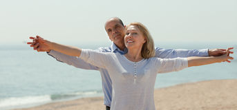 Elderly couple at sea shore Stock Photography