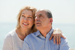 Elderly couple at sea shore Stock Photo