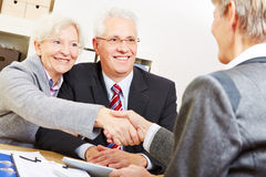 Elderly couple shaking hands Stock Photo