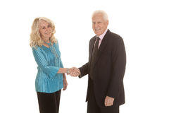Elderly couple shaking hands Royalty Free Stock Photos
