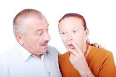 Elderly couple shocked. The Elderly couple shocked and thinking together Royalty Free Stock Images