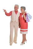 Elderly couple and shopping bags. Portrait of a happy elderly couple and shopping bags Stock Photo