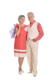 Elderly couple and shopping bags. Portrait of a happy elderly couple and shopping bags Royalty Free Stock Photography