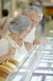 Elderly couple in shopping mall Royalty Free Stock Photo